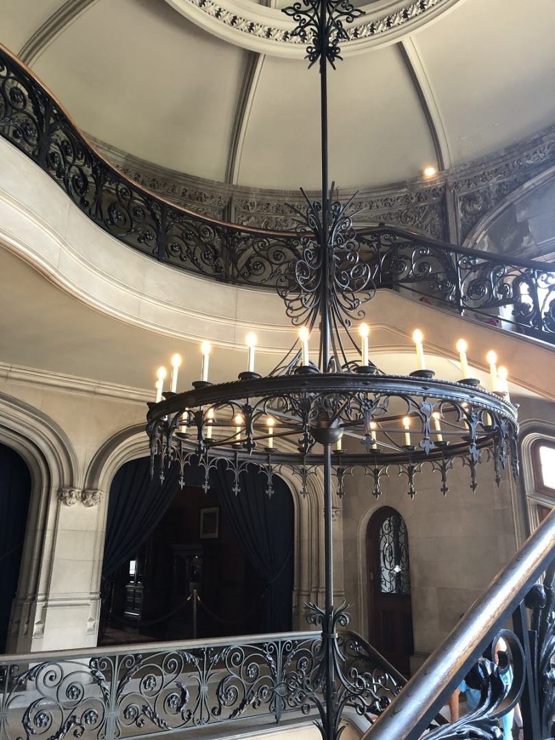 circular staircase, wrought iron chandelier
