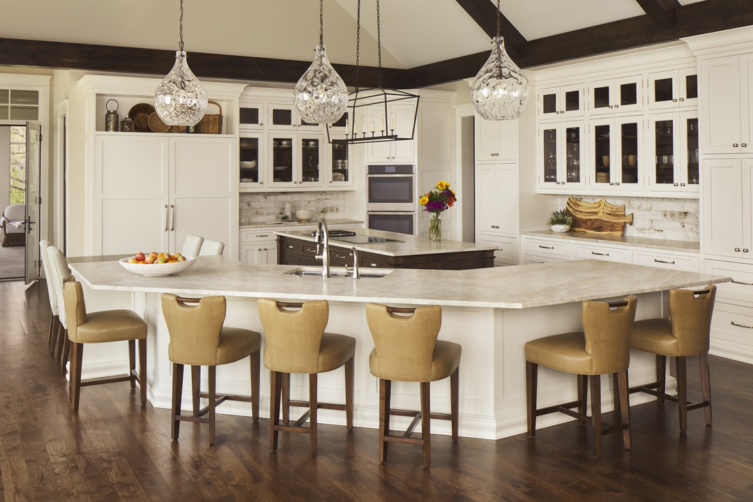 white kitchen, lake house kitchen, two islands, island stools, pendant lights, glass front cabinets, wood floor