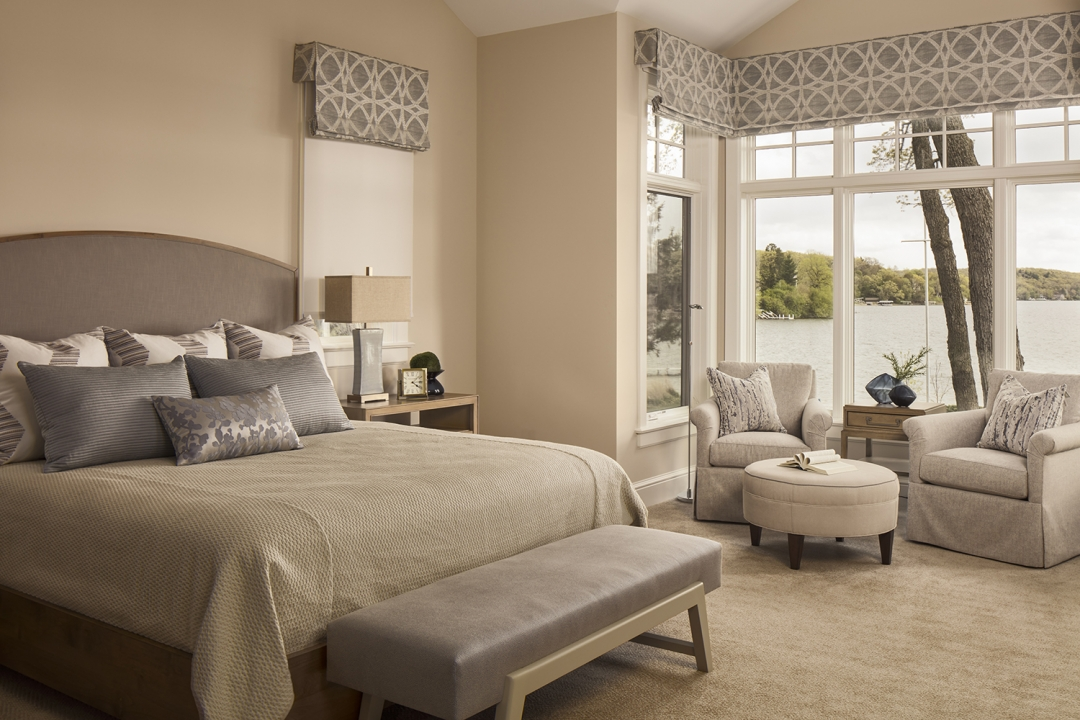 master bedroom, neutral palette, arm chairs, round ottoman, bench, window treatments, pillows, bedding, table lamp, accessories, carpet