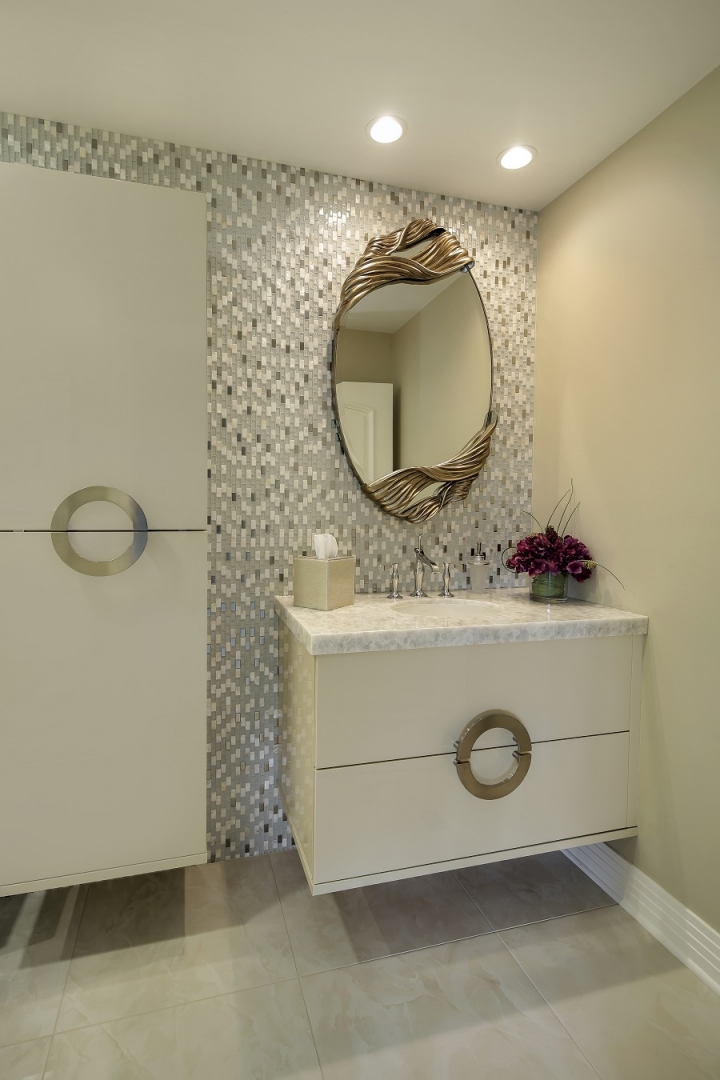 gold embellished bathroom mirror