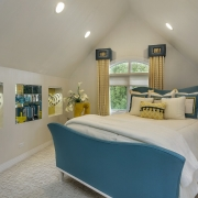 To pull together the color palette of this bedroom, we custom designed blue and gold pillows. Photo by www.lmphotography.com