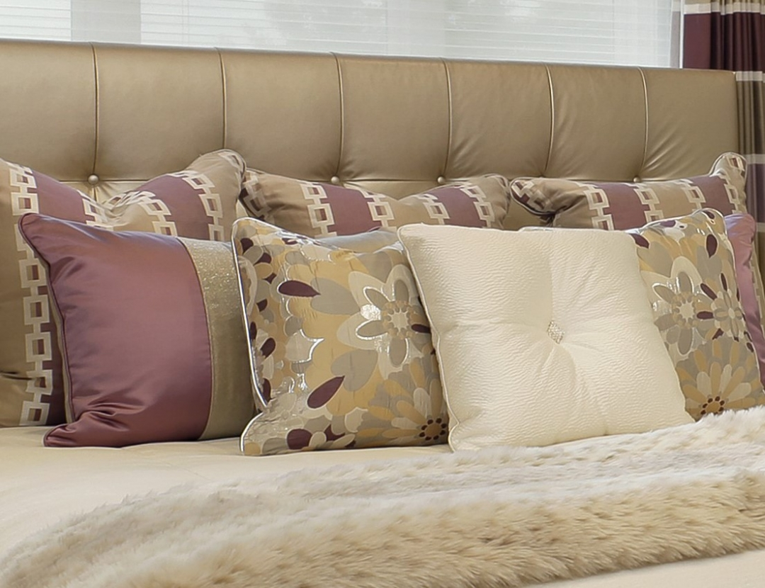Mixing patterns and textures builds a lot of interest in this pile of pillows. Photo by www.lmphotography