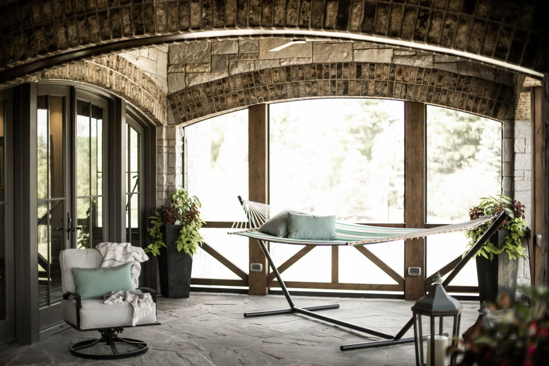 "This screened porch is perfect for ""me"" time. Photo by Matt Warren Photography"