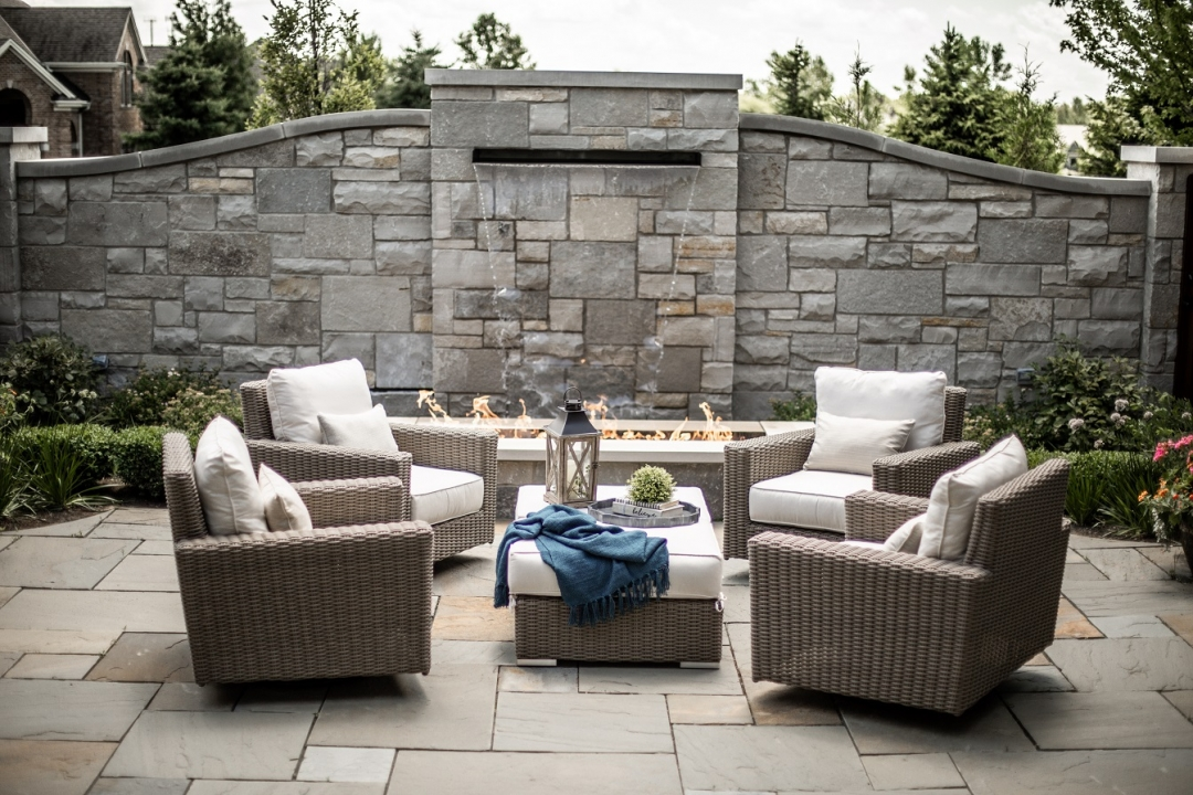 Swivel chairs ensure that everyone can turn to enjoy the water wall and fire place or join the conversation. Photo by Matt Warren Photography.