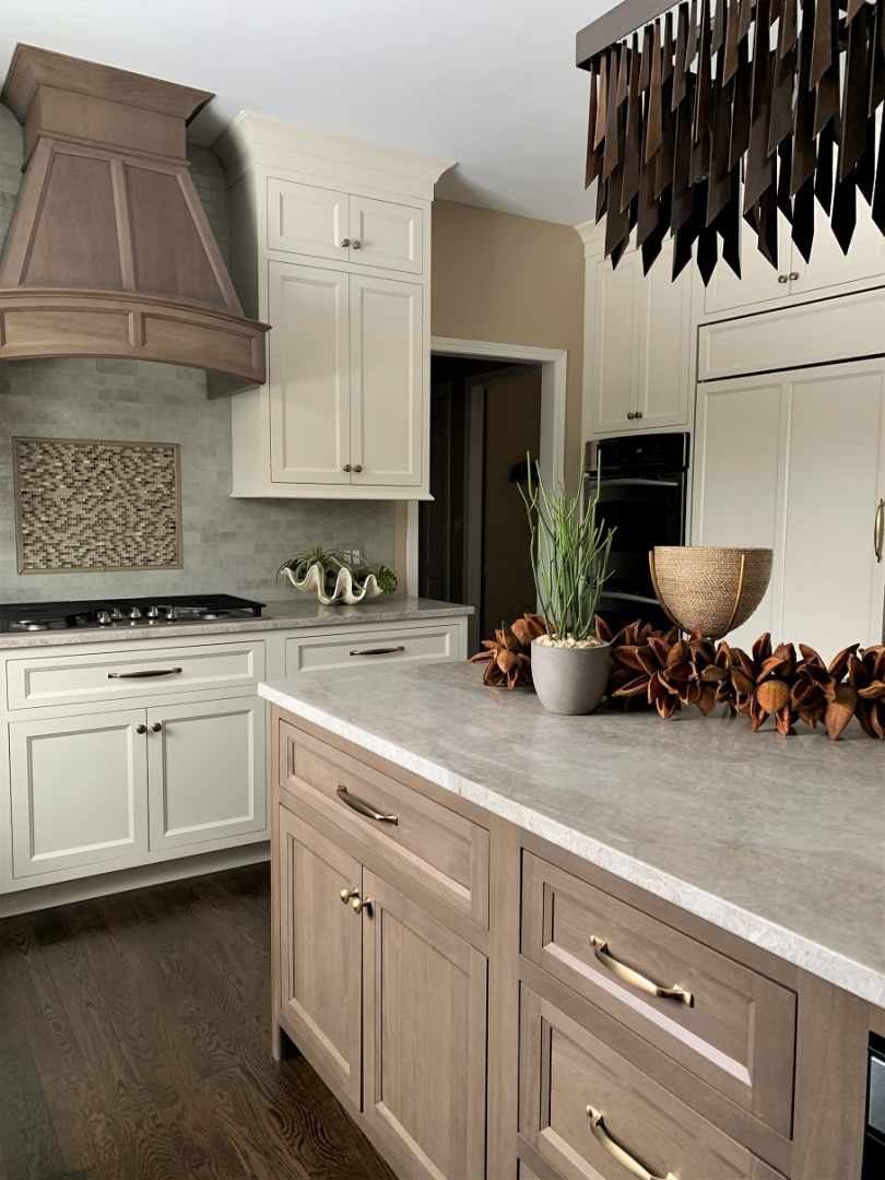 The quartzite countertop unifies the dual finishes of the cabinetry beautifully. Photo by IEG
