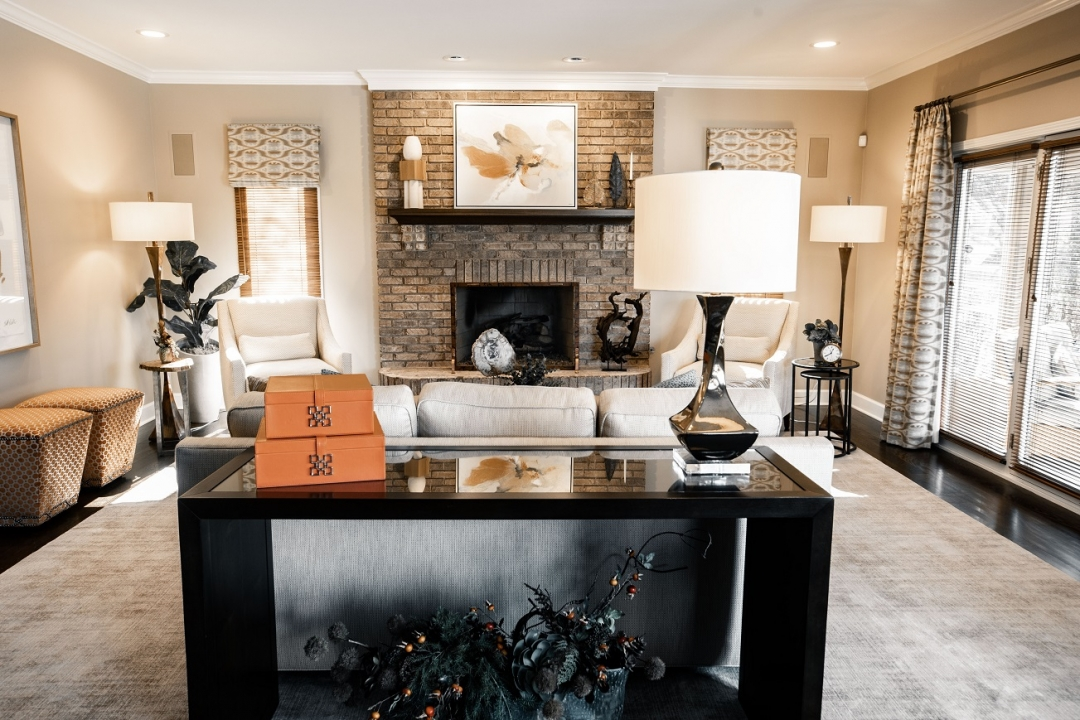 Great room renovation, transitional style, console table, brick fireplace, accessories