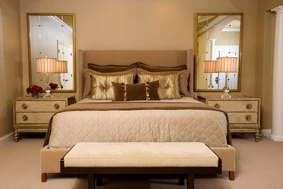 traditional bedroom, night stands, bedside lamps, mirros, upholstered bench, bedding, pillows, headboard