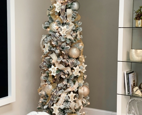 Office Christmas tree, ribbons, metallic balls, fleur-de-lis ornaments, flocked branches