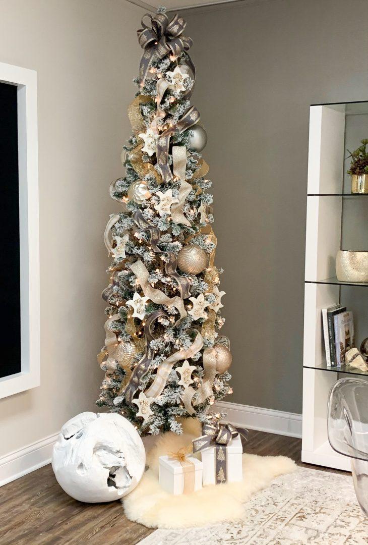 Office Christmas tree, ribbons, metallic balls, fleur-de-lis ornaments, flocked branches