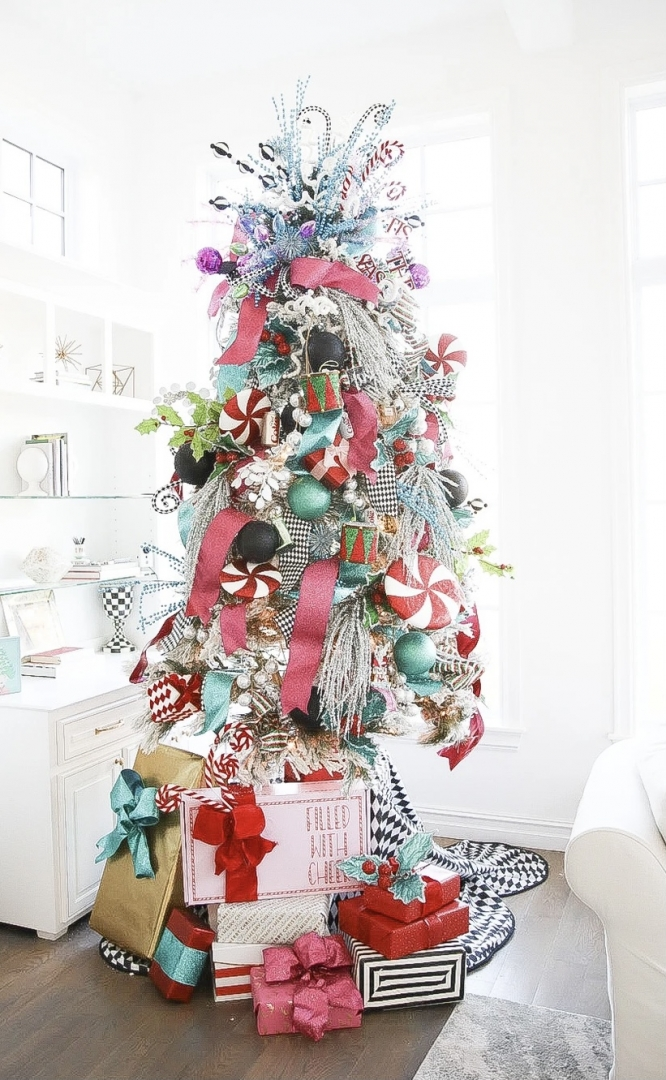 whimsical residential christmas tree, pink and acqua, black and white christmas tree skirt, wrapped gifts, lollypop ornaments