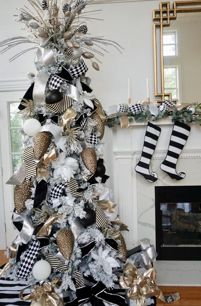 residential christmas tree, black and white ribbons, gold and silver ornaments, striped christmas stockings
