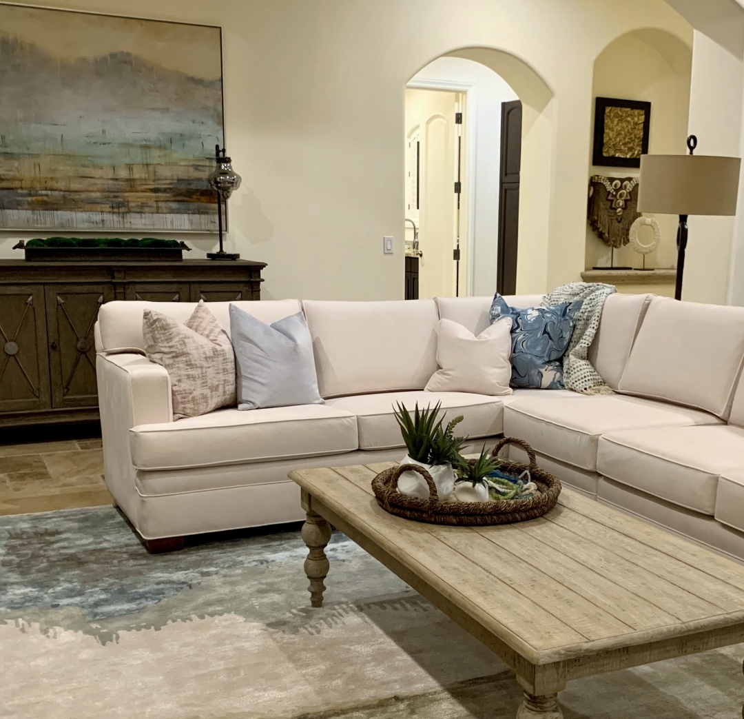 great room, sectional sofa, cocktail table, rug, pillows, wall art, chest, accessories