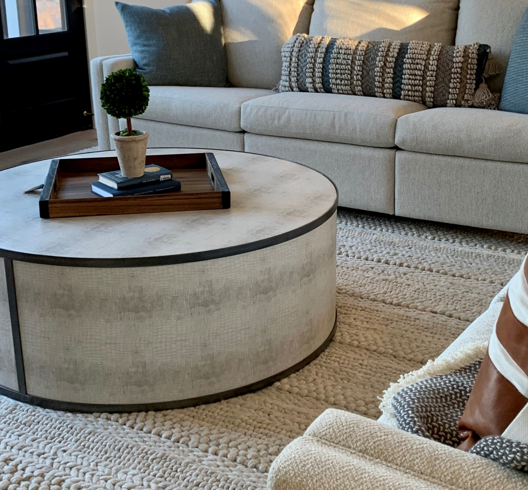 family room, wool rug, round ottoman, light sofa, throw pillows, accessories, tray