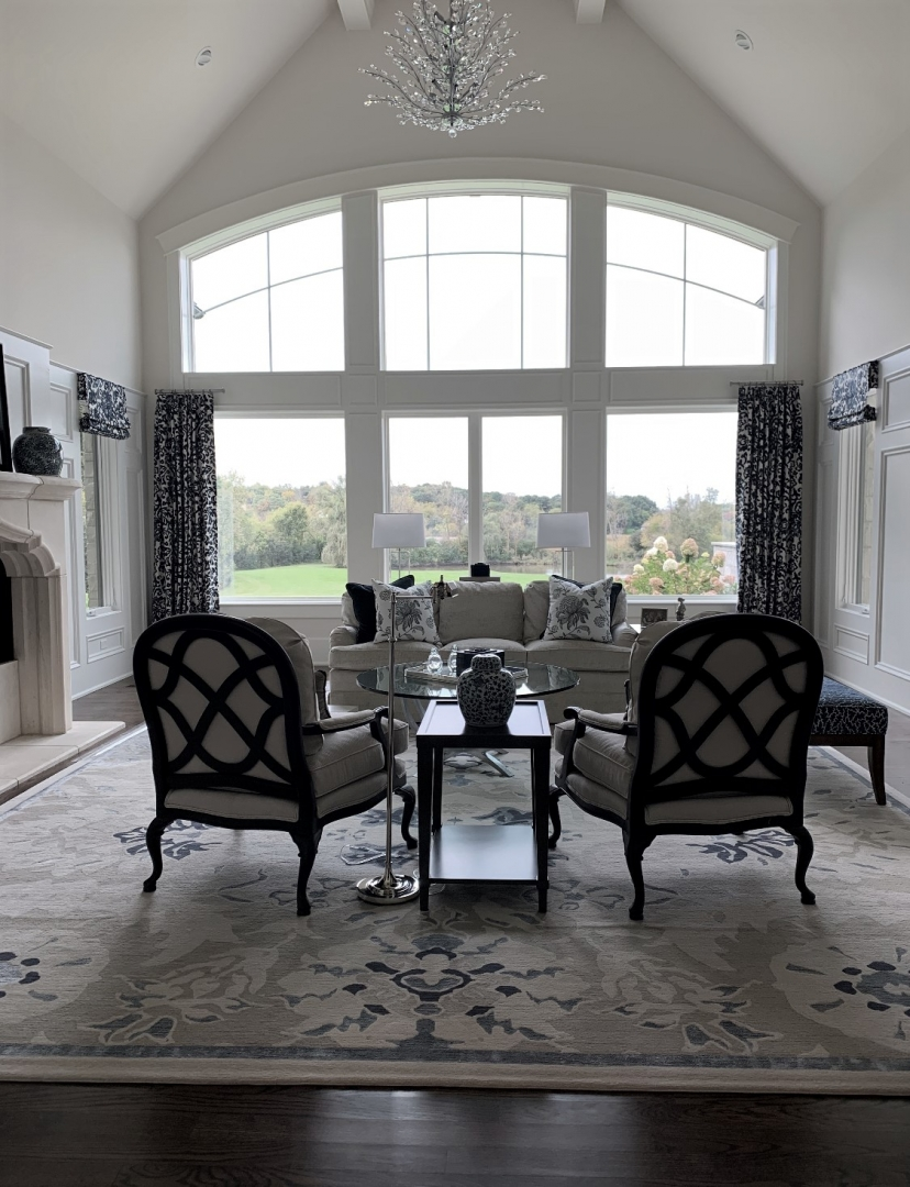 traditional living room, cahirs, end table, sofa, rug, window panels, chandelier, window wall, accessories