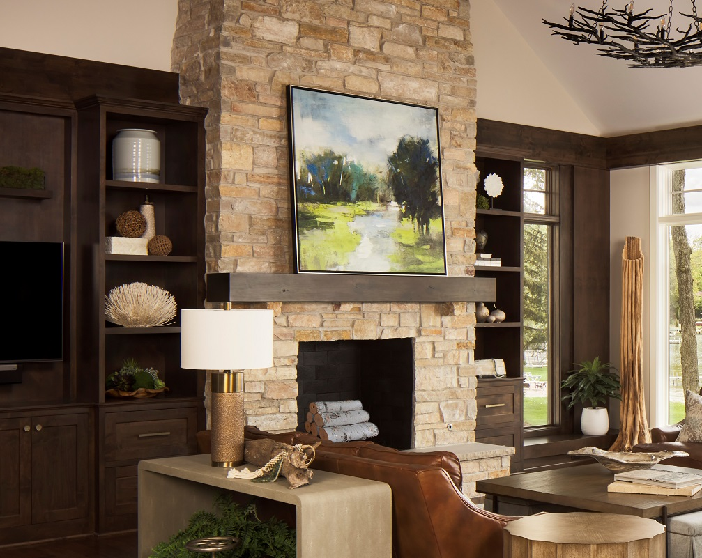 great room, stone fireplace, cabinets, leather sofas, console table, table lamp, cocktail table, side table, ottomans, arm chair, rug, accessories, lake view