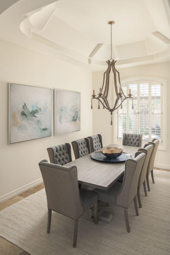 dining room, dining room table, dining room chairs, chandelier, wall art, rug, windows, wood floor
