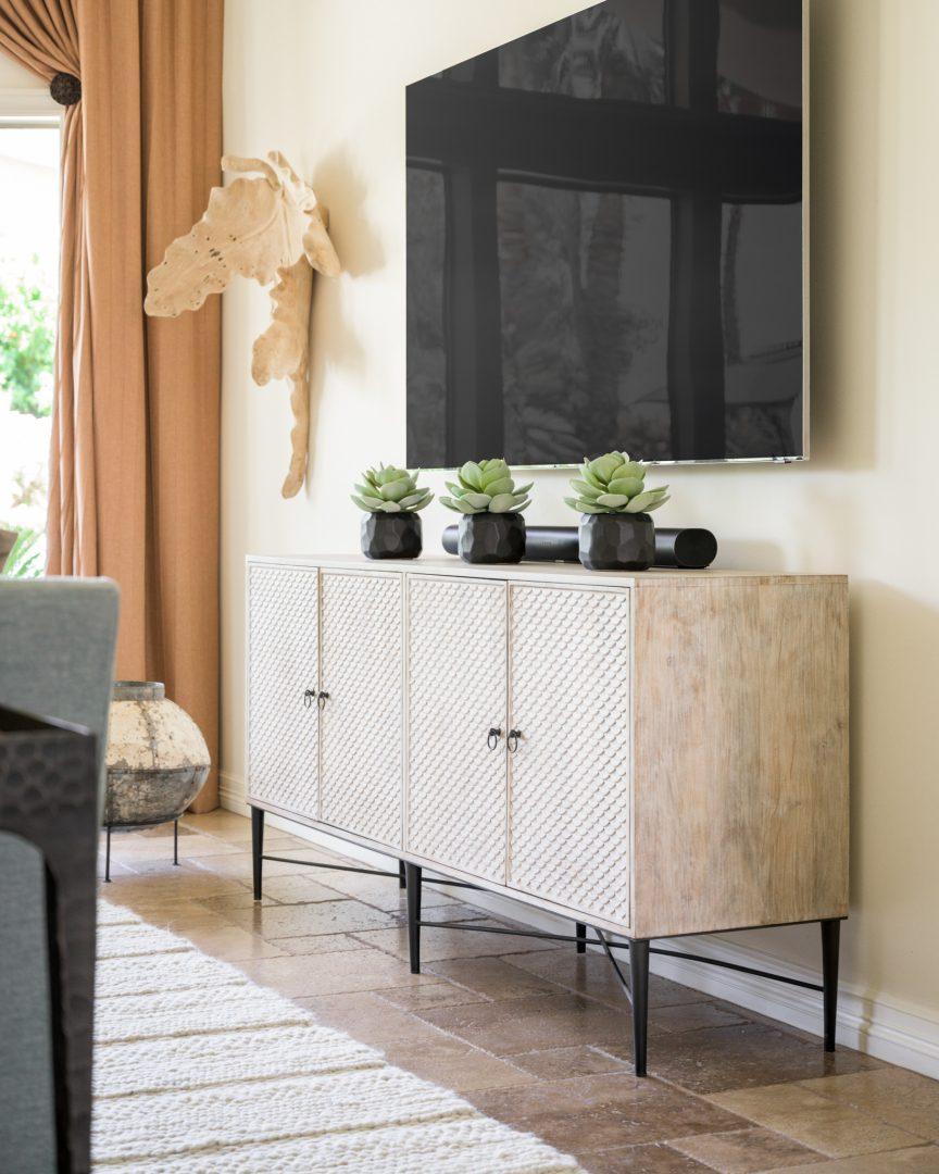 dining room, dining room chest, wall art, rug, wood floor, wall-mounted TV