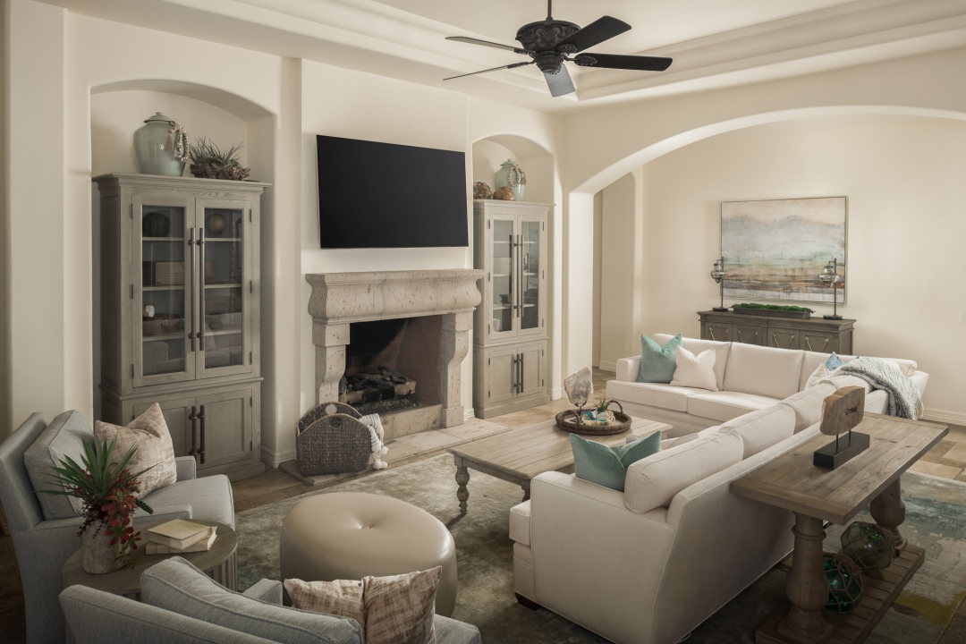 living room, sectional sofa, arm chairs, cocktail table, sofa table, ottoman, fireplace, wall-mounted TV, glass-front cabinets, accessories, pillows