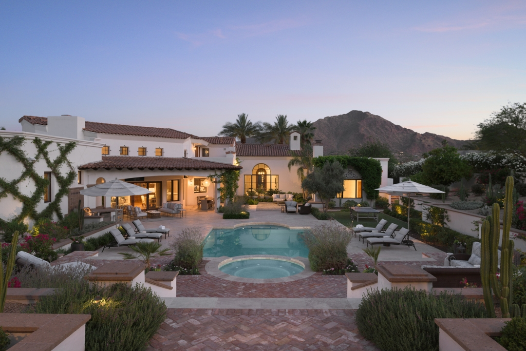outdoor pool, in-ground pool, brick pool deck, chaise lounges, patio umbrellas, landscaping, mountains, cactus
