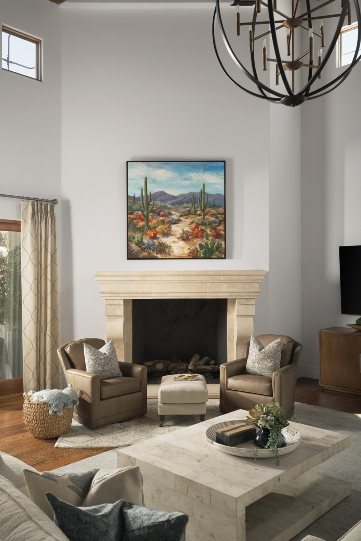 great room, stone fireplace, swivel chairs, ottoman, rug, accessories, wall art, geometric window panels, wicker basket