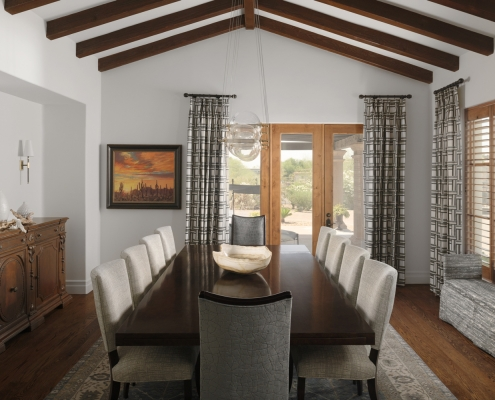 dining room, dining room table, dining room chairs, area rug, bench, window panels, ornate chest, accessories, white walls, wood floor