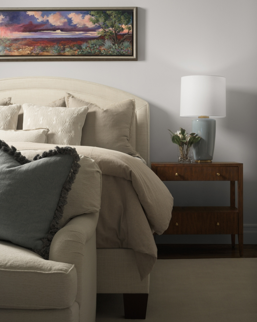 master bedroom, bedding, upholstered headboard, pillows, night stand, table lamp, wall art